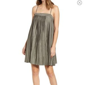 Green pleated cocktail dress